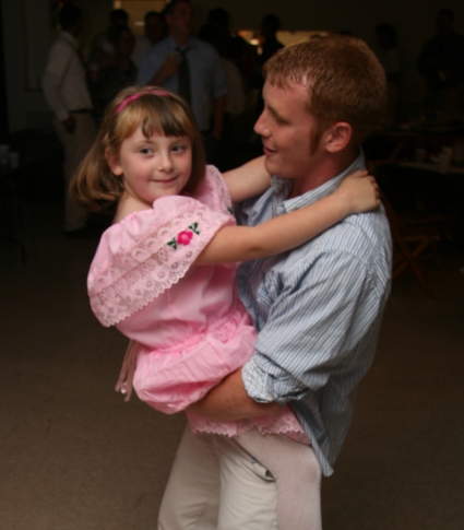 A father and his daughet dancing.
