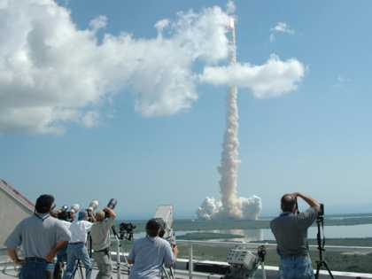 Shuttle Discovery lifts off on the first new shuttle mission.