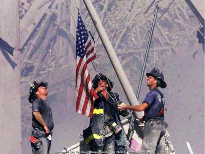 Raising Old Glory over the ruins of 9-11 by NYC firefighters